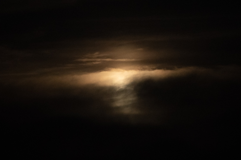 A moon shape hidden in the clouds