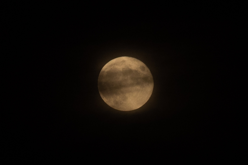 Moon with a cloud in front of it